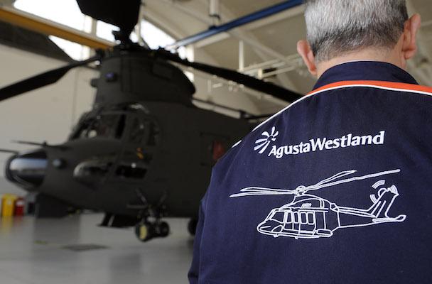 AugustaWestland employee walks inside an hangar at the headquarters in Vergiate